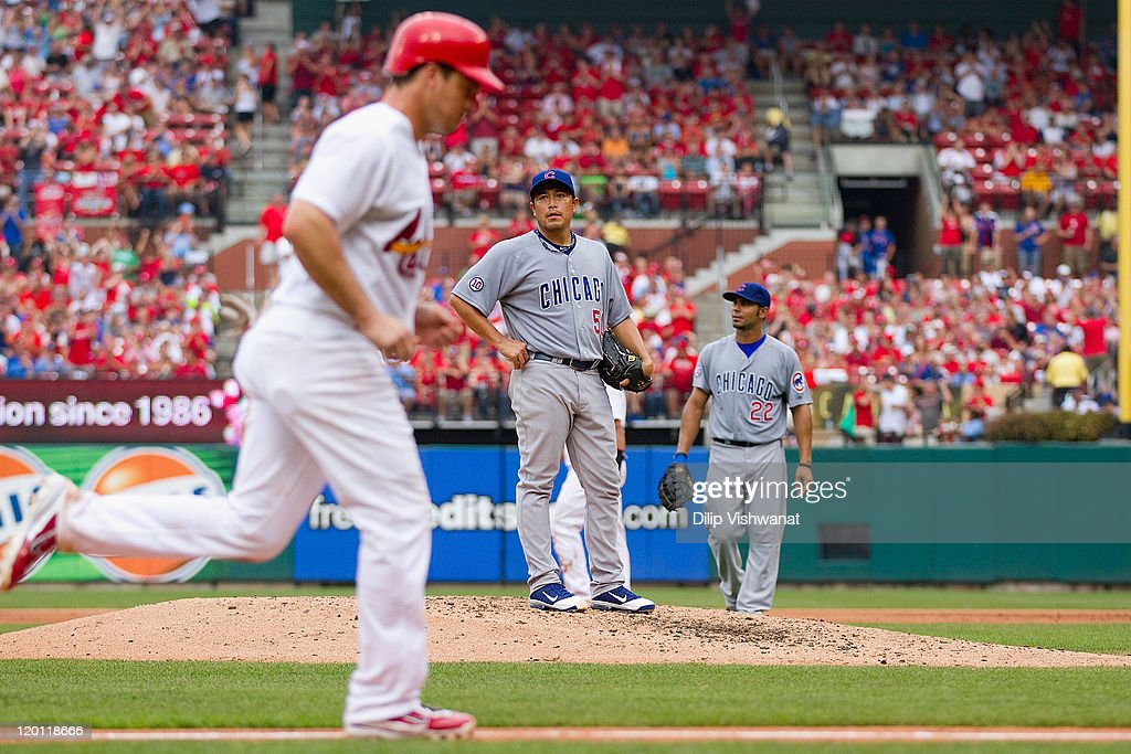 Starter <a gi-track='captionPersonalityLinkClicked' href=/galleries/search?phrase=Rodrigo+Lopez&family=editorial&specificpeople=216384 ng-click='$event.stopPropagation()'>Rodrigo Lopez</a> #50 of the Chicago Cubs reacts after walking in a run against the St. Louis Cardinals at Busch Stadium on July 30, 2011 in St. Louis, Missouri.
