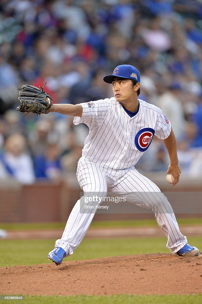 Starter Tsuyoshi Wada of the Chicago Cubs delivers a pitch during the second inning against the Colorado Rockies on July 28 2014 at Wrigley Field in...