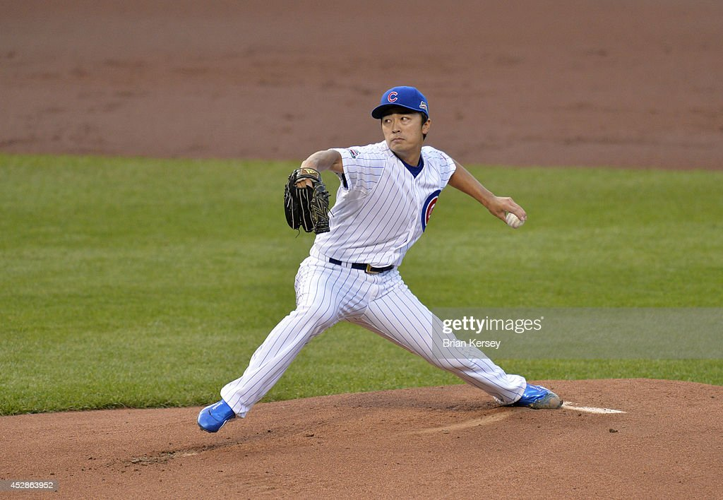 Starter Tsuyoshi Wada of the Chicago Cubs delivers a pitch during the first inning against the Colorado Rockies on July 28 2014 at Wrigley Field in...