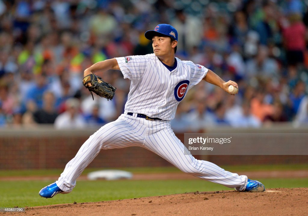 Starter Tsuyoshi Wada of the Chicago Cubs delivers a pitch during the second inning against the San Francisco Giants at Wrigley Field on August 19...