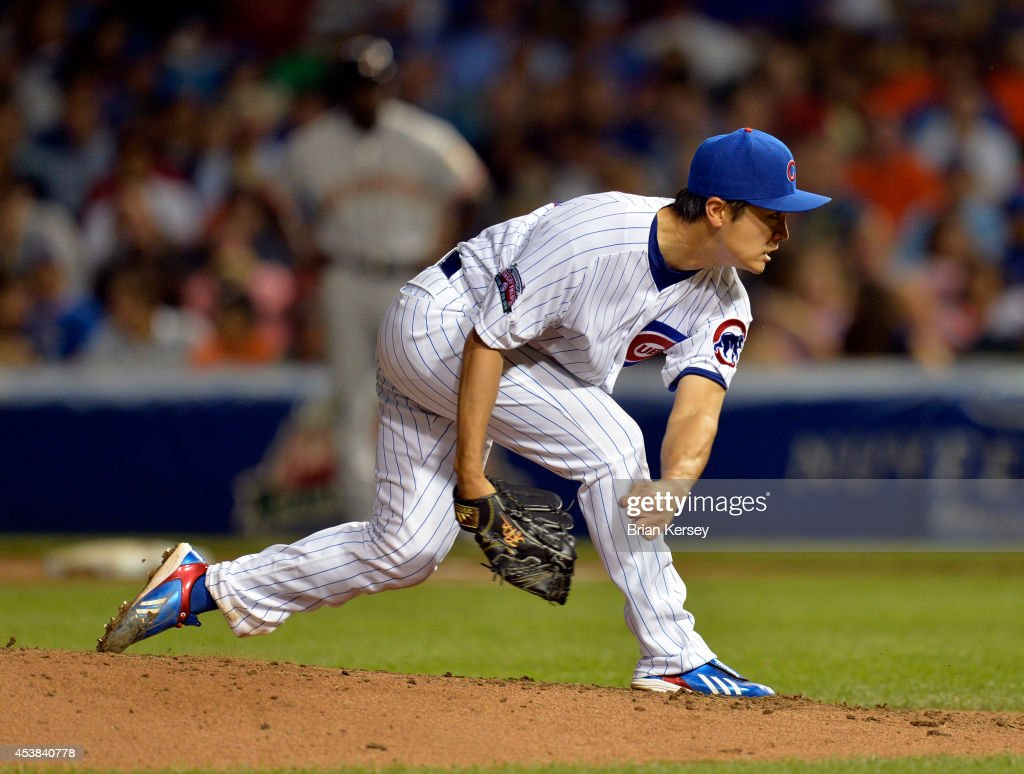 Starter Tsuyoshi Wada of the Chicago Cubs delivers a pitch during the third inning against the San Francisco Giants at Wrigley Field on August 19...
