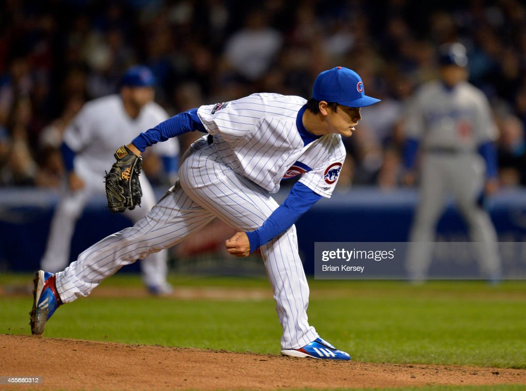 Starter Tsuyoshi Wada of the Chicago Cubs delivers a pitch during the fourth inning against the Los Angeles Dodgers at Wrigley Field on September 18...