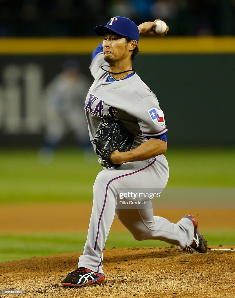 Starter <a gi-track='captionPersonalityLinkClicked' href=/galleries/search?phrase=Yu+Darvish&family=editorial&specificpeople=4018539 ng-click='$event.stopPropagation()'>Yu Darvish</a> #11 of the Texas Rangers pitches in the first inning against the Seattle Mariners at Safeco Field on April 12, 2013 in Seattle, Washington.