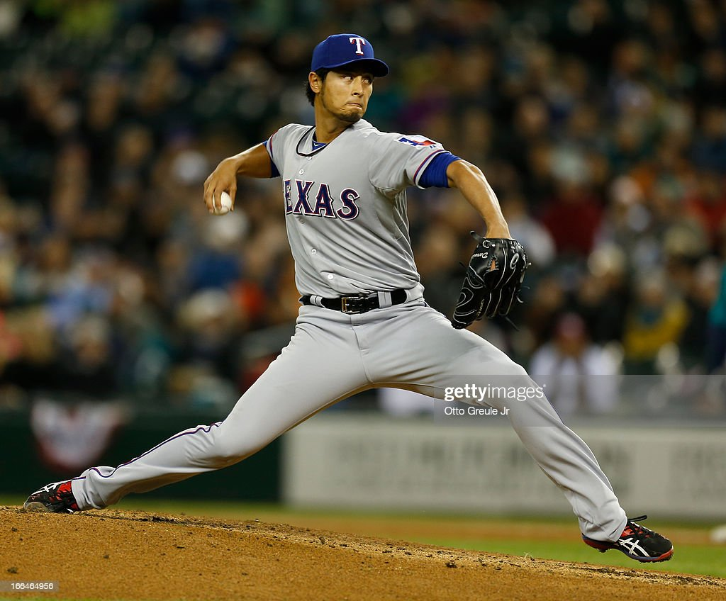 Starter <a gi-track='captionPersonalityLinkClicked' href=/galleries/search?phrase=Yu+Darvish&family=editorial&specificpeople=4018539 ng-click='$event.stopPropagation()'>Yu Darvish</a> #11 of the Texas Rangers pitches in the second inning against the Seattle Mariners at Safeco Field on April 12, 2013 in Seattle, Washington.