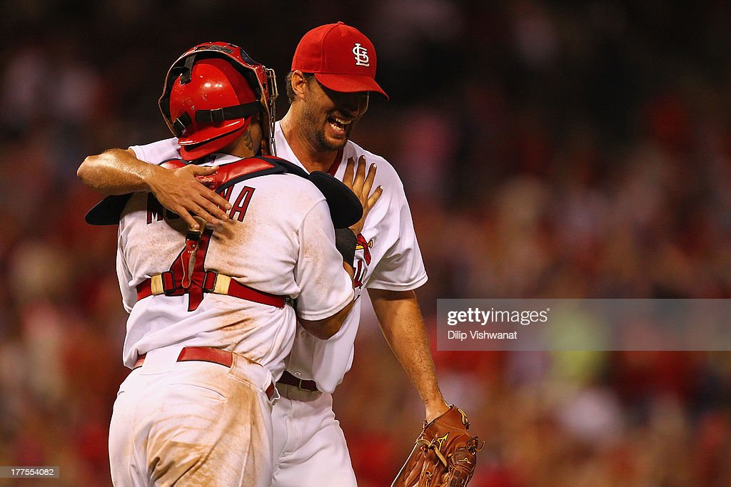 Starteting pitcher <a gi-track='captionPersonalityLinkClicked' href=/galleries/search?phrase=Adam+Wainwright&family=editorial&specificpeople=547879 ng-click='$event.stopPropagation()'>Adam Wainwright</a> #50 of the St. Louis Cardinals celebrates with <a gi-track='captionPersonalityLinkClicked' href=/galleries/search?phrase=Yadier+Molina&family=editorial&specificpeople=172002 ng-click='$event.stopPropagation()'>Yadier Molina</a> #4 after throwing a complete game to beat the Atlanta Braves at Busch Stadium on August 23, 2013 in St. Louis, Missouri. The Cardinals beat the Braves 3-1.