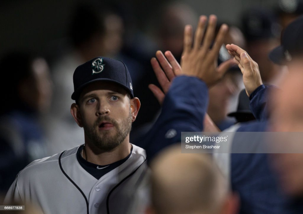 Startin pitcher James Paxton #65 of the Seattle Mariners is congratulated by teammates after pitching eight innings and giving up two hits to the Texas Rangers during a game at Safeco Field on April 15, 2017 in Seattle, Washington. The Mariners won the game 5-0. All players are wearing #42 in honor of Jackie Robinson Day.