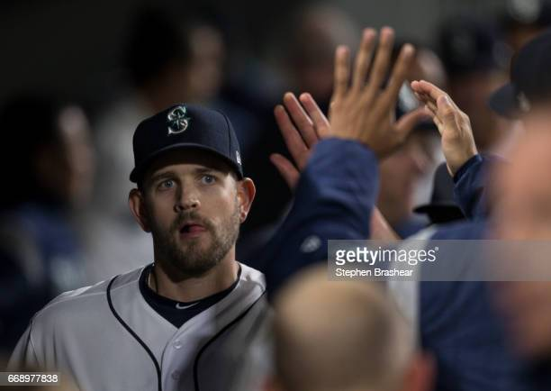 Startin pitcher James Paxton of the Seattle Mariners is congratulated by teammates after pitching eight innings and giving up two hits to the Texas...