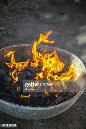 Starting a charcoal fire for grilling. : Stock Photo
