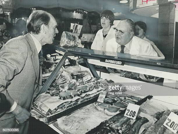 Starting early Conservative Leader Robert Stanfield went campaigning Saturday in St Lawrence Market stopping at one point to talk with butchers...