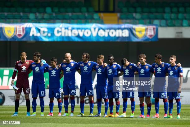 Starting eleven of Torino FC observe a minute of silence for Michele Scarponi prior to the Serie A football match between AC ChievoVerona and Torino...