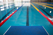 Starting line in indoor swimming pool.
