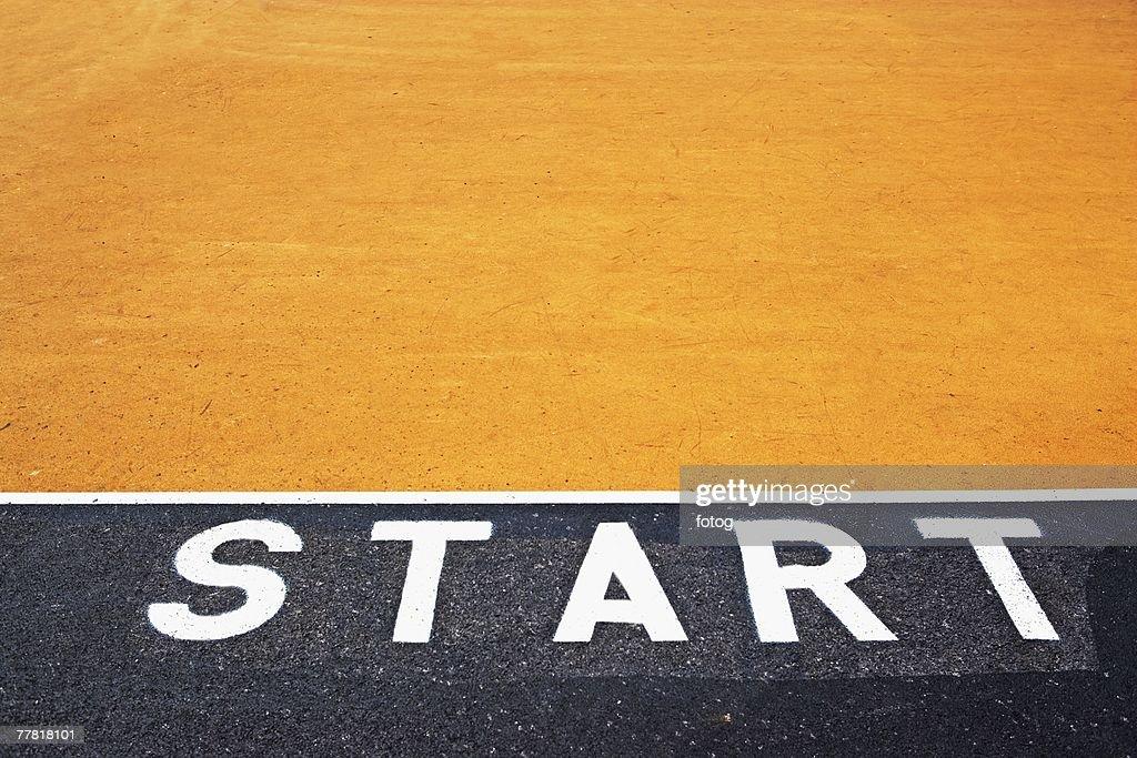Starting line painted on asphalt