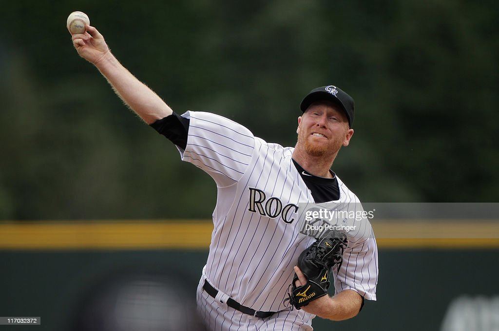 Starting pitcher Aaron Cook of the Colorado Rockies delivers against the Detroit Tigers at Coors Field on June 19 2011 in Denver Colorado
