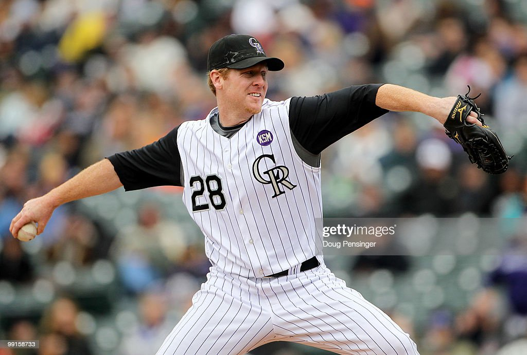Starting pitcher Aaron Cook of the Colorado Rockies delivers against the Philadelphia Phillies at Coors Field on May 12 2010 in Denver Colorado The...