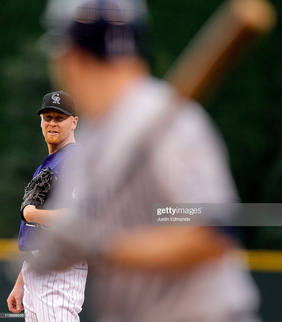 Starting pitcher Aaron Cook of the Colorado Rockies looks for a sign against Chase Headley of the San Diego Padres during the first inning at Coors...
