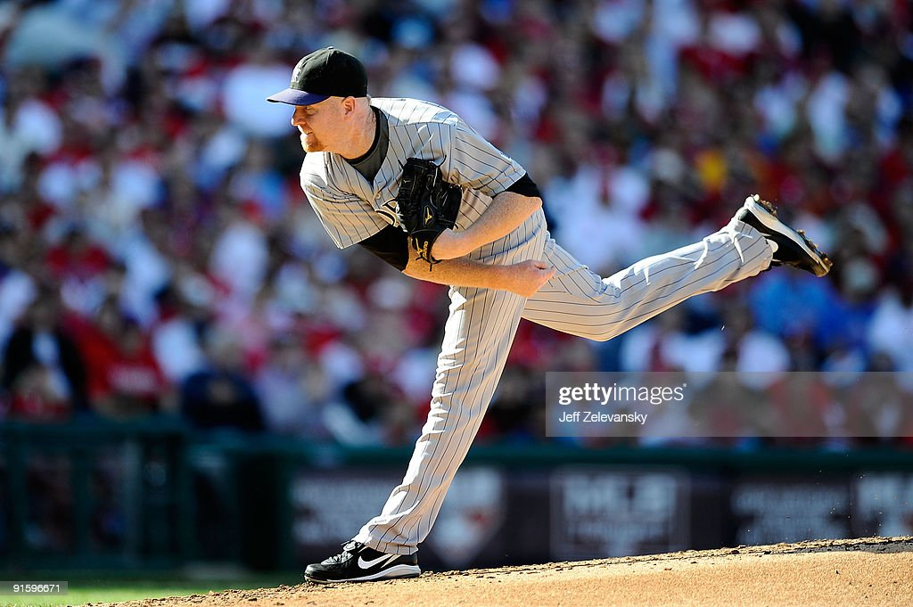 Starting pitcher Aaron Cook of the Colorado Rockies throws a pitch against the Philadelphia Phillies in Game Two of the NLDS during the 2009 MLB...