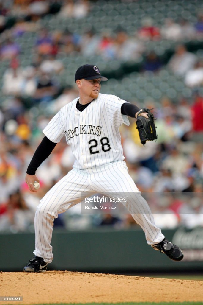 Starting pitcher Aaron Cook of the Colorado Rockies throws against the Cincinnati Reds on August 7 2004 at Coors Field in Denver Colorado