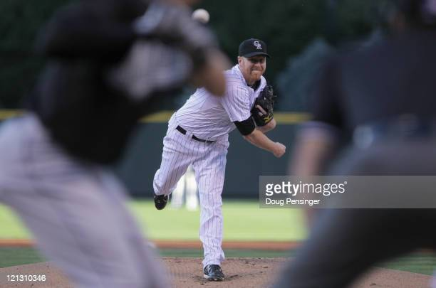 Starting pitcher Aaron Cook of the Colorado Rockies works against the Florida Marlins at Coors Field on August 17 2011 in Denver Colorado Cook earned...