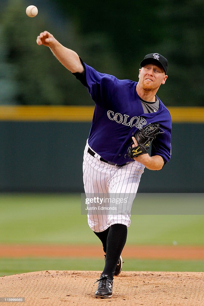 Starting pitcher Aaron Cook of the Colorado Rockies works the first inning against the San Diego Padres at Coors Field on June 13 2011 in Denver...
