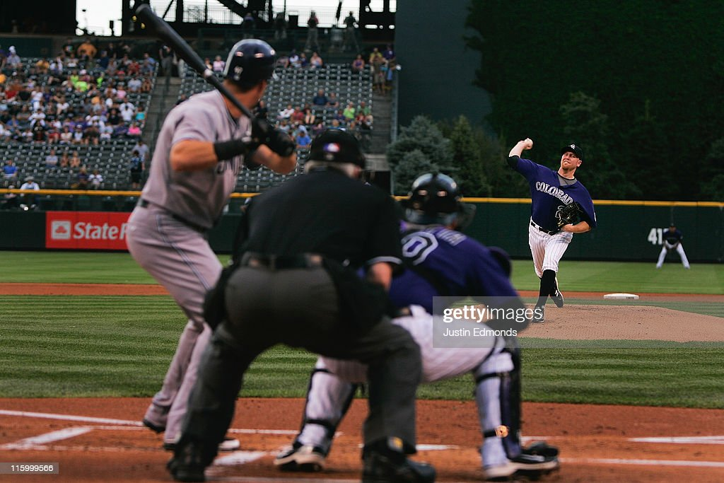 Starting pitcher Aaron Cook of the Colorado Rockies works the first inning against Jason Bartlett of the San Diego Padres at Coors Field on June 13...
