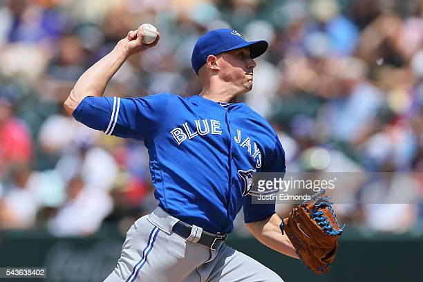 Starting pitcher Aaron Sanchez of the Toronto Blue Jays delivers to home plate during the third inning against the Colorado Rockies at Coors Field on...