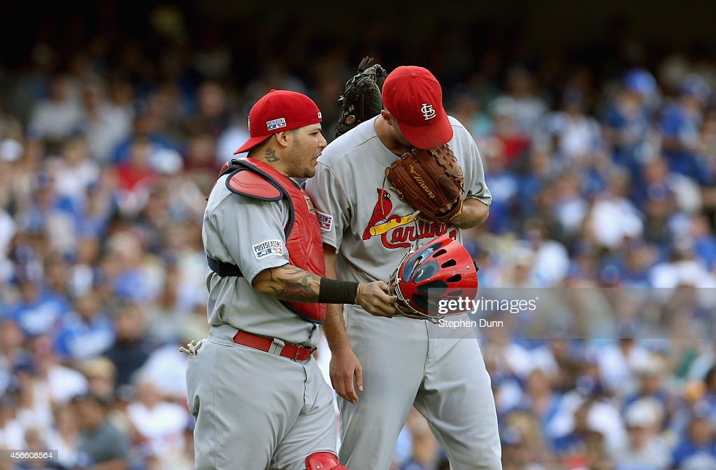 Starting pitcher <a gi-track='captionPersonalityLinkClicked' href=/galleries/search?phrase=Adam+Wainwright&family=editorial&specificpeople=547879 ng-click='$event.stopPropagation()'>Adam Wainwright</a> #50 of the St. Louis Cardinals and catcher <a gi-track='captionPersonalityLinkClicked' href=/galleries/search?phrase=Yadier+Molina&family=editorial&specificpeople=172002 ng-click='$event.stopPropagation()'>Yadier Molina</a> #4 talk during the second inning against the Los Angeles Dodgers during Game One of the National League Division Series at Dodger Stadium on October 3, 2014 in Los Angeles, California.