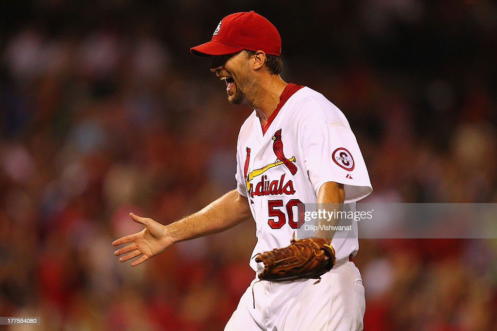 Starting pitcher <a gi-track='captionPersonalityLinkClicked' href=/galleries/search?phrase=Adam+Wainwright&family=editorial&specificpeople=547879 ng-click='$event.stopPropagation()'>Adam Wainwright</a> #50 of the St. Louis Cardinals celebrates after throwing a complete game to beat the Atlanta Braves at Busch Stadium on August 23, 2013 in St. Louis, Missouri. The Cardinals beat the Braves 3-1.
