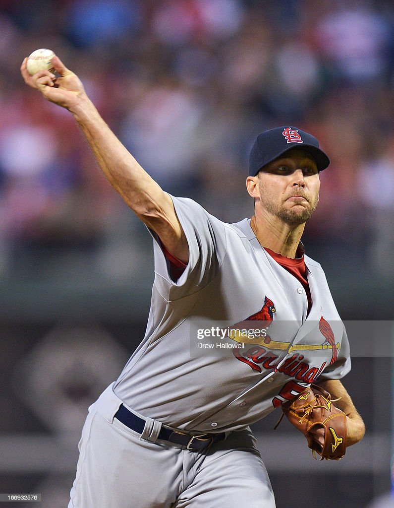 Starting pitcher <a gi-track='captionPersonalityLinkClicked' href=/galleries/search?phrase=Adam+Wainwright&family=editorial&specificpeople=547879 ng-click='$event.stopPropagation()'>Adam Wainwright</a> #50 of the St. Louis Cardinals delivers a pitch in the first inning during the game against the Philadelphia Phillies at Citizens Bank Park on April 18, 2013 in Philadelphia, Pennsylvania.