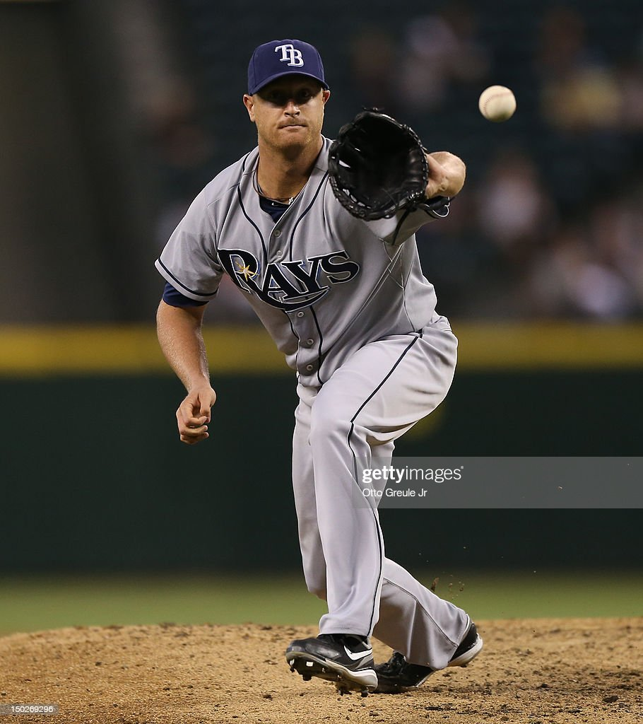 Starting pitcher <a gi-track='captionPersonalityLinkClicked' href=/galleries/search?phrase=Alex+Cobb&family=editorial&specificpeople=7512114 ng-click='$event.stopPropagation()'>Alex Cobb</a> #53 of the Tampa Bay Rays fields a bouncing ball ground out by John Jaso #27 of the Seattle Mariners at Safeco Field on August 13, 2012 in Seattle, Washington.