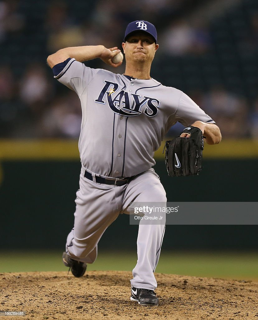 Starting pitcher <a gi-track='captionPersonalityLinkClicked' href=/galleries/search?phrase=Alex+Cobb&family=editorial&specificpeople=7512114 ng-click='$event.stopPropagation()'>Alex Cobb</a> #53 of the Tampa Bay Rays pitches against the Seattle Mariners at Safeco Field on August 13, 2012 in Seattle, Washington.