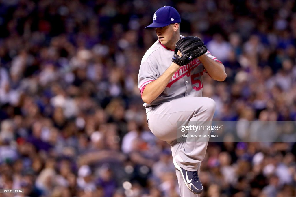 Starting pitcher Alex Wood #57 of the Los Angeles Dodgers throws in the seventh inning against the Colorado Rockies at Coors Field on May 13, 2017 in Denver, Colorado. Members of both teams were wearing pink in commemoration of Mother's Day weekend.