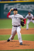Starting pitcher Alfredo Aceves of the Boston Red Sox pitches during the game against the Cleveland Indians at Progressive Field on April 17 2013 in...