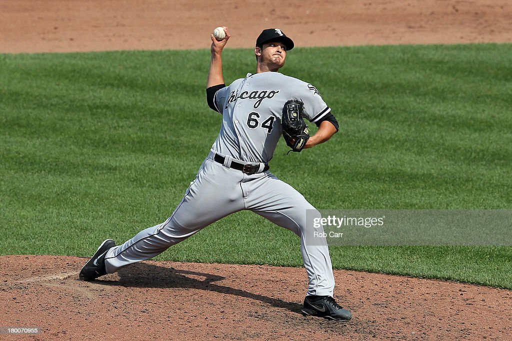 Starting pitcher Andre Rienzo #64 of the Chicago White Sox throws to a Baltimore Orioles batter during the sixth inning at Oriole Park at Camden Yards on September 8, 2013 in Baltimore, Maryland.