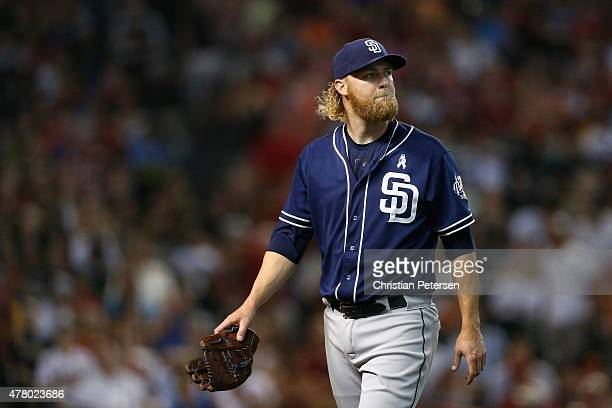 Starting pitcher Andrew Cashner of the San Diego Padres reacts as he walks back to the dugout following the second inning of the MLB game against the...