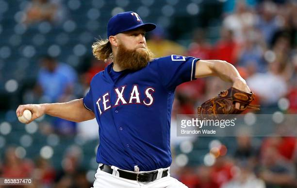 Starting pitcher Andrew Cashner of the Texas Rangers throws during the first inning of a baseball game against the Houston Astros at Globe Life Park...