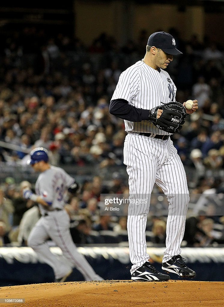 Starting pitcher <a gi-track='captionPersonalityLinkClicked' href=/galleries/search?phrase=Andy+Pettitte&family=editorial&specificpeople=201753 ng-click='$event.stopPropagation()'>Andy Pettitte</a> #46 of the New York Yankees reacts as <a gi-track='captionPersonalityLinkClicked' href=/galleries/search?phrase=Josh+Hamilton+-+Baseball+Player&family=editorial&specificpeople=234355 ng-click='$event.stopPropagation()'>Josh Hamilton</a> #32 of the Texas Rangers rounds third base on his 2-run home tun in the top of the first inning of Game Three of the ALCS during the 2010 MLB Playoffs at Yankee Stadium on October 18, 2010 in New York, New York.