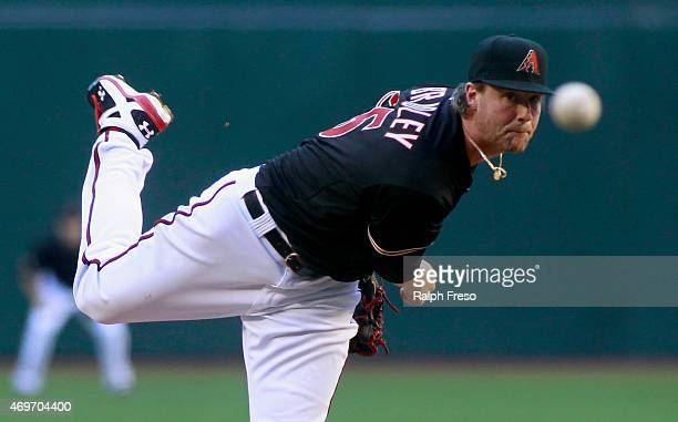 Starting pitcher Archie Bradley of the Arizona Diamondbacks delivers a pitch against the Los Angeles Dodgers during the first inning of an MLB game...