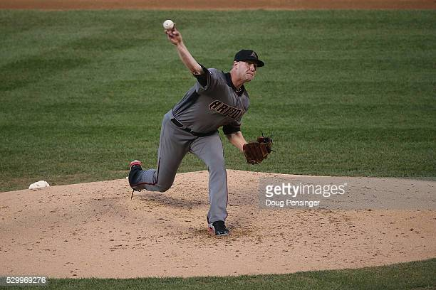 Starting pitcher Archie Bradley of the Arizona Diamondbacks delivers against the Colorado Rockies as he earned the win at Coors Field on May 09 2016...