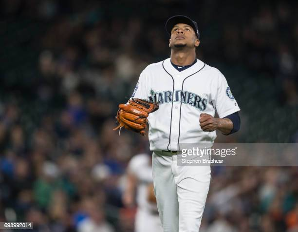 Starting pitcher Ariel Miranda of the Seattle Mariners reacts as he walks off after pitching the seventh inning during a game against the Detroit...
