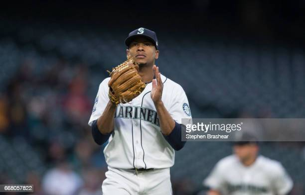 Starting pitcher Ariel Miranda of the Seattle Mariners reacts while walking off the field after pitching an inning during a game at Safeco Field on...