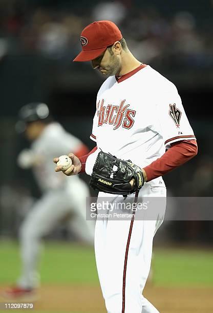 Starting pitcher Armando Galarraga of the Arizona Diamondbacks reacts after giving up a solo home run to Lance Berkman of the St Louis Cardinals...