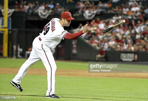 Starting pitcher Armando Galarraga of the Arizona Diamondbacks throws a bat back to Yadier Molina of the St Louis Cardinals during the Major League...