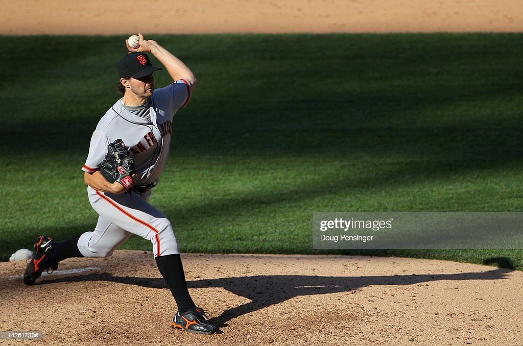 Starting pitcher <a gi-track='captionPersonalityLinkClicked' href=/galleries/search?phrase=Barry+Zito&family=editorial&specificpeople=202943 ng-click='$event.stopPropagation()'>Barry Zito</a> #75 of the San Francisco Giants delivers against the Colorado Rockies on Opening Day at Coors Field on April 9, 2012 in Denver, Colorado. Zito pitched a complete game and earned the win as the Giants defeated the Rockies 7-0.