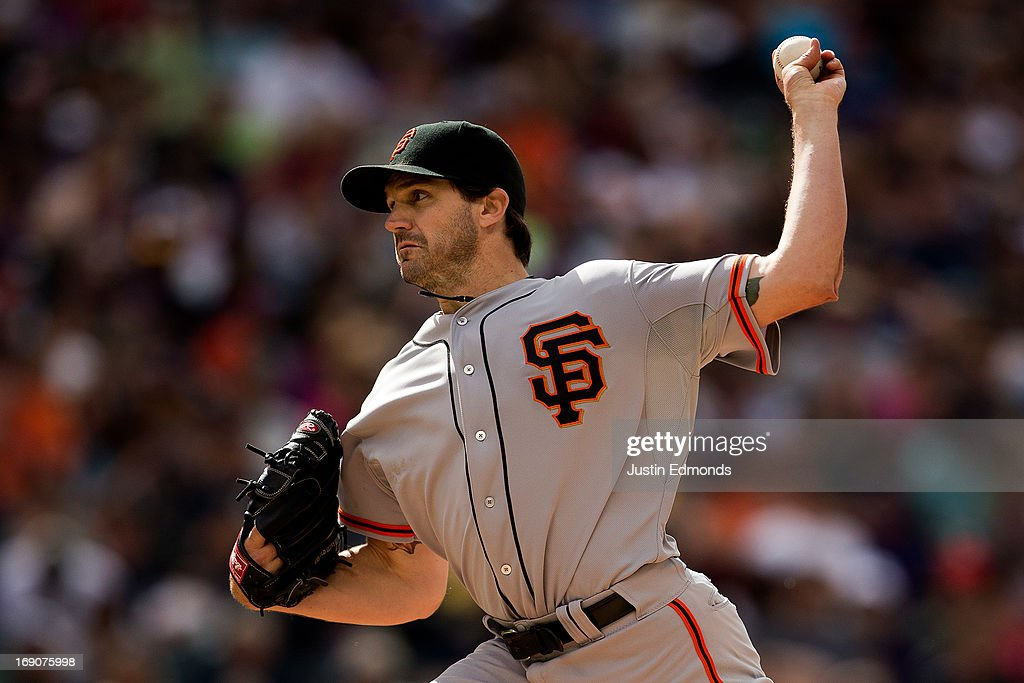 Starting pitcher <a gi-track='captionPersonalityLinkClicked' href=/galleries/search?phrase=Barry+Zito&family=editorial&specificpeople=202943 ng-click='$event.stopPropagation()'>Barry Zito</a> #75 of the San Francisco Giants delivers to home plate against the Colorado Rockies at Coors Field on May 19, 2013 in Denver, Colorado. The Rockies defeated the Giants 5-0.