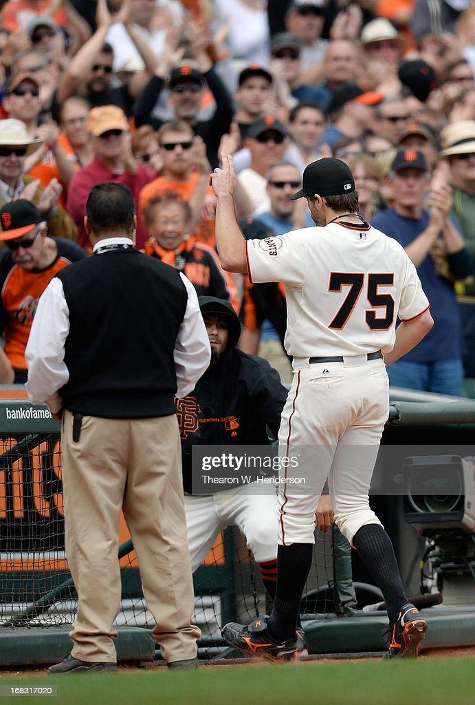 Starting pitcher <a gi-track='captionPersonalityLinkClicked' href=/galleries/search?phrase=Barry+Zito&family=editorial&specificpeople=202943 ng-click='$event.stopPropagation()'>Barry Zito</a> #75 of the San Francisco Giants salutes the fans as he leaves the game against the Philadelphia Phillies in the eighth inning at AT&T Park on May 8, 2013 in San Francisco, California.
