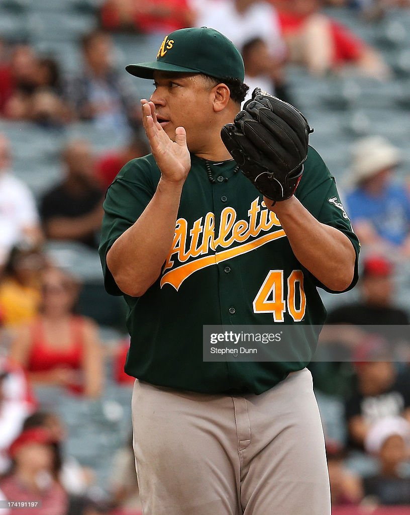 Starting pitcher <a gi-track='captionPersonalityLinkClicked' href=/galleries/search?phrase=Bartolo+Colon&family=editorial&specificpeople=175812 ng-click='$event.stopPropagation()'>Bartolo Colon</a> #40 of the Oakland Athletics celebrates after the final out of his complete game shutout against the Los Angeles Angels of Anaheim at Angel Stadium of Anaheim on July 21, 2013 in Anaheim, California. Oakland won 6-0.