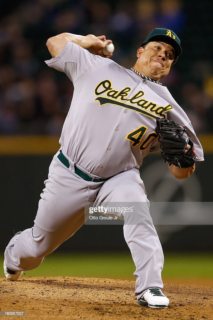 Starting pitcher <a gi-track='captionPersonalityLinkClicked' href=/galleries/search?phrase=Bartolo+Colon&family=editorial&specificpeople=175812 ng-click='$event.stopPropagation()'>Bartolo Colon</a> #40 of the Oakland Athletics pitches in the first inning against the Seattle Mariners at Safeco Field on September 27, 2013 in Seattle, Washington.