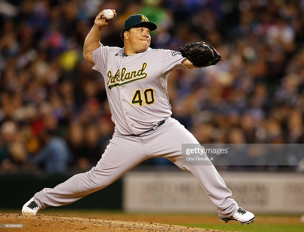 Starting pitcher <a gi-track='captionPersonalityLinkClicked' href=/galleries/search?phrase=Bartolo+Colon&family=editorial&specificpeople=175812 ng-click='$event.stopPropagation()'>Bartolo Colon</a> #40 of the Oakland Athletics pitches in the fifth inning against the Seattle Mariners at Safeco Field on September 27, 2013 in Seattle, Washington.