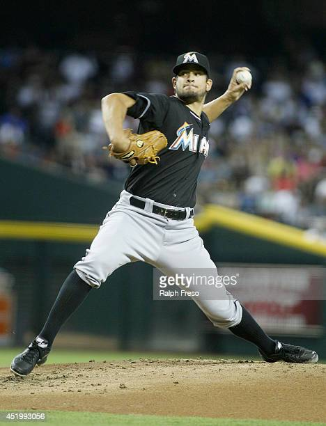 Starting pitcher Brad Hand of the Miami Marlins throws a pitch against the Arizona Diamondbacks during the first inning of a MLB game at Chase Field...