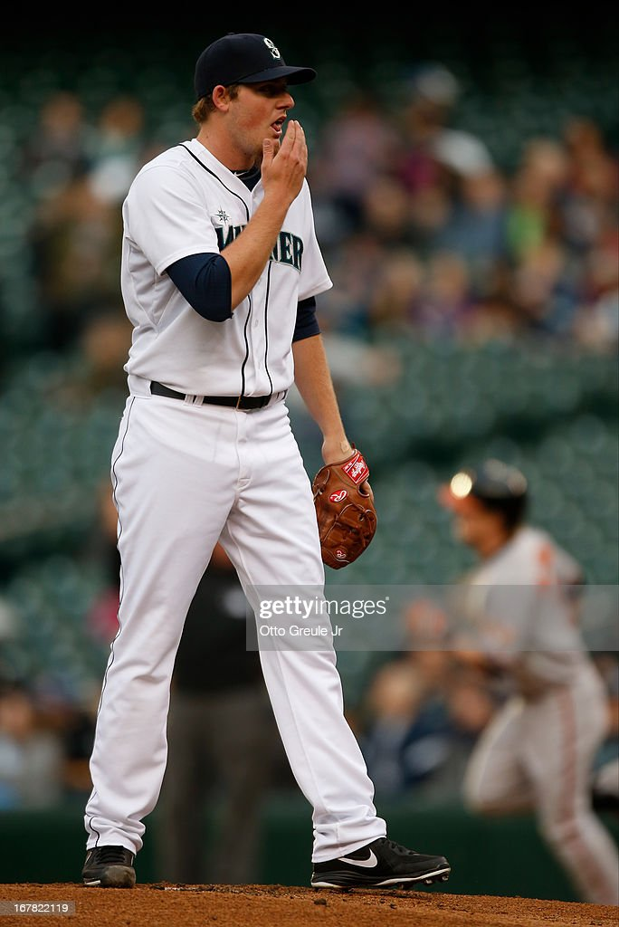 Starting pitcher Brandon Maurer #37 of the Seattle Mariners regroups after giving up a home run to Nate McLouth of the Baltimore Orioles in the first inning at Safeco Field on April 30, 2013 in Seattle, Washington.
